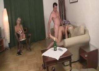 Mom and daughter take turns pleasuring daddy