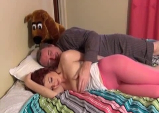 Dad seducing his little daughter on a bed