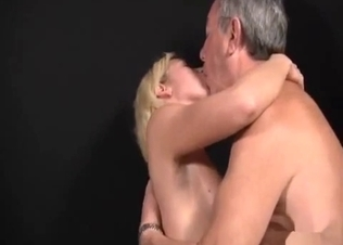 Short-haired blonde fucks her elderly dad