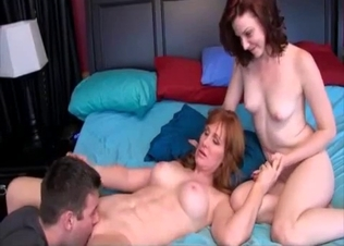 Redhead and her daughter fuck a hung guy