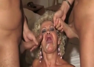 Tanned and curly MILF fucks her two sons