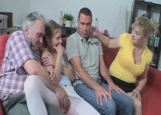 Foursome family fucking on a red couch